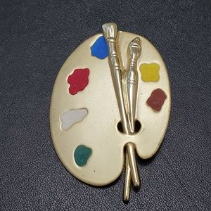 AJG gold tone painter's pallet brooch